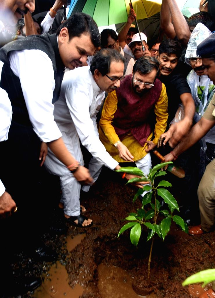 Maharashtra Chief Minister Devendra Fadnavis, Union Environment Minister Prakash Javadekar and Shiv Sena chief Uddhav Thackeray plant saplings to mark 'Vanamahotsav' - forest festival - at ... - Devendra Fadnavis