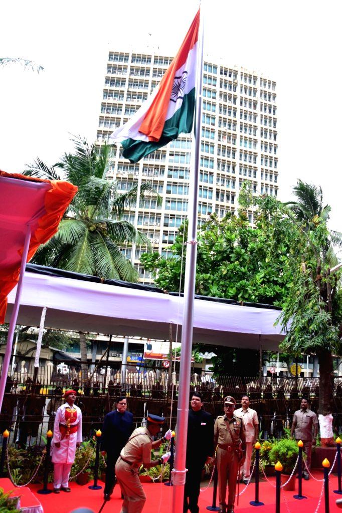 Maharashtra Chief Minister Devendra Fadnavis hoists the national flag during Independence Day in Mumbai on Aug 15, 2016. - Devendra Fadnavis