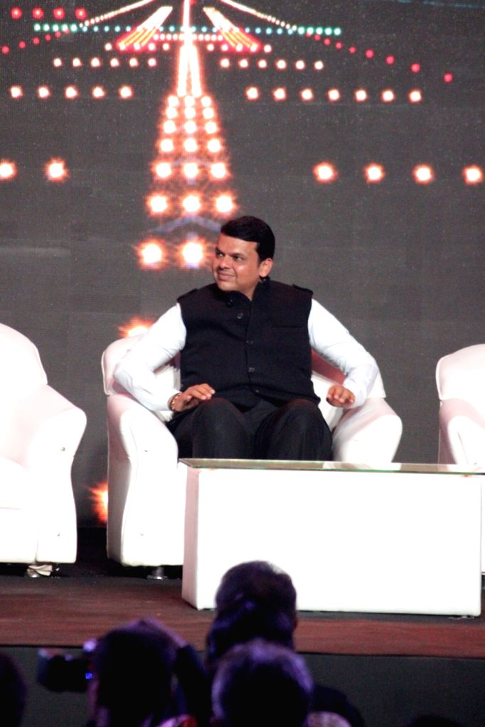 Maharashtra Chief Minister Devendra Fadnavis during the launch of Nationalist Congress Party (NCP) leader Praful Patel's pictorial biography Udaan in Mumbai on May 14, 2017. - Devendra Fadnavis and Praful Patel