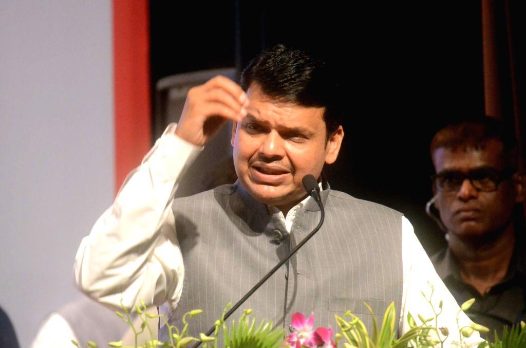 Maharashtra Chief Minister Devendra Fadnavis addresses during a business conference in Mumbai on July 2, 2017. - Devendra Fadnavis