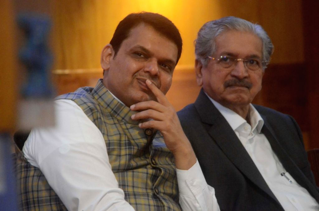 Maharashtra Chief Minister Devendra Fadnavis along with  Industries Minister Subhash Desai during the bell ringing ceremony at the listing of two hundred companies on Bombay Stock Exchange ... - Devendra Fadnavis and Subhash Desai