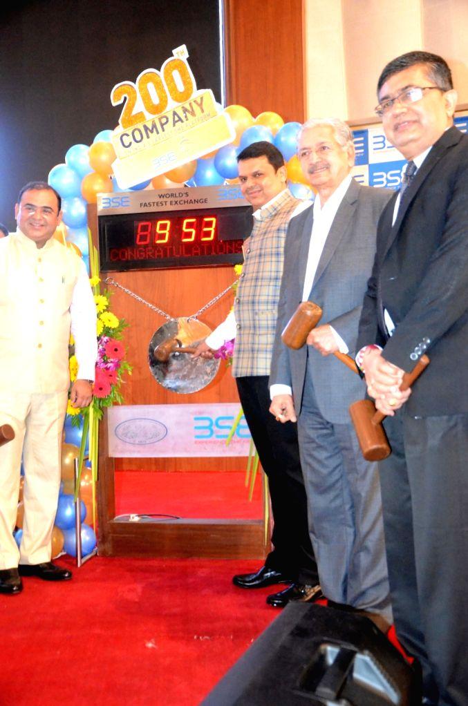 Maharashtra Chief Minister Devendra Fadnavis rings the bell during the listing of two hundred companies on Bombay Stock Exchange (BSE) in Mumbai on Oct 5, 2017. Also seen Maharshtra Cabinet ... - Devendra Fadnavis, Minister Subhash Desai, Jayakumar Jitendrasinh Rawal and Ashishkumar Chauhan
