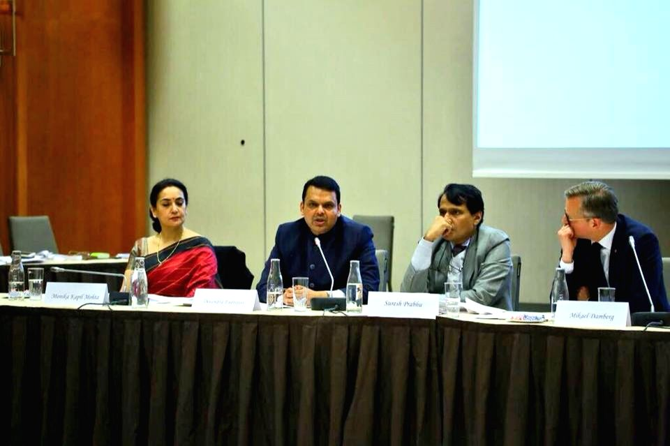 Maharashtra Chief Minister Devendra Fadnavis addresses during the Business ers Conference in Stockholm, Sweden on Oct 11, 2017. Also seen Union Commerce and Industry Minister Suresh ... - Devendra Fadnavis and Suresh Prabhu