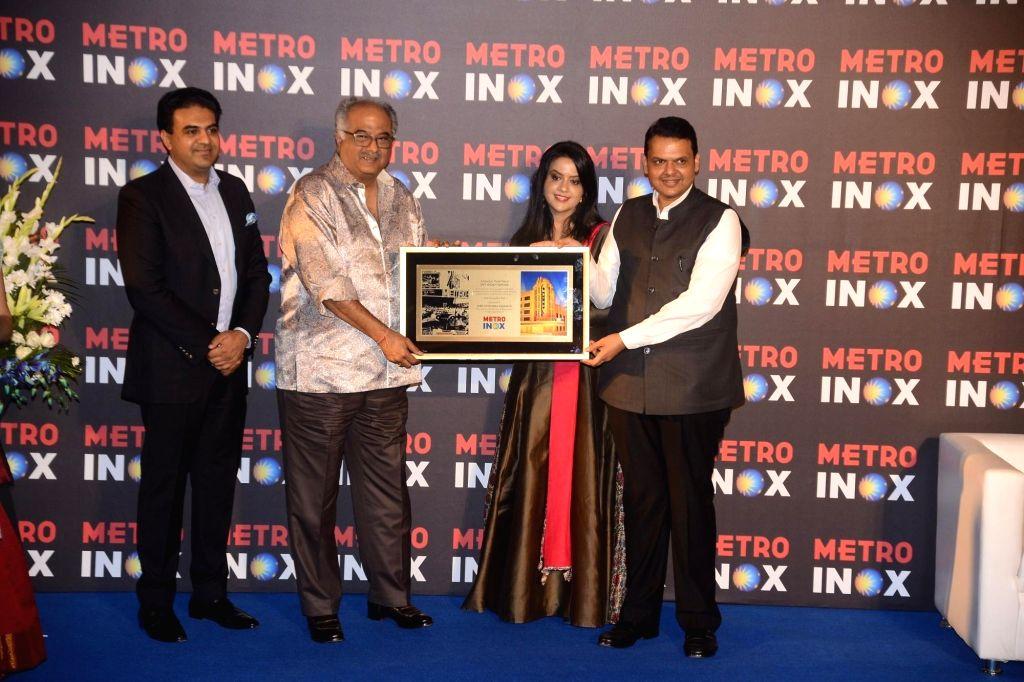 Maharashtra Chief Minister Devendra Fadnavis along with his wife and singer-Banker Amruta Fadnavis and producer Boney Kapoor at the inauguration of a cinema theater in Mumbai on Nov 29, 2017. - Devendra Fadnavis and Kapoor