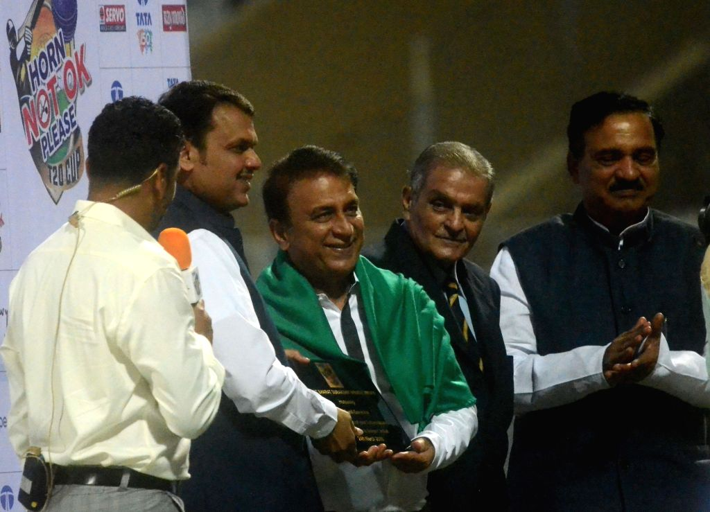 Maharashtra Chief Minister Devendra Fadnavis along with the state's cabinet minister Diwakar Raote felicitate Former cricketer Sunil Gavaskar ahead of Horn Not Ok Please T20 Cup match at ... - Devendra Fadnavis