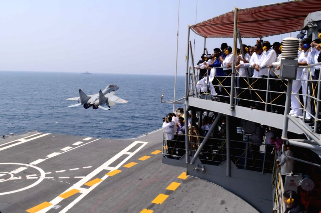 Maharashtra Chief Minister Devendra Fadnavis witness a demonstration of naval exercises during a 'day at sea' organised by Indian Navy in Arabian Sea on April 4, 2018. - Devendra Fadnavis