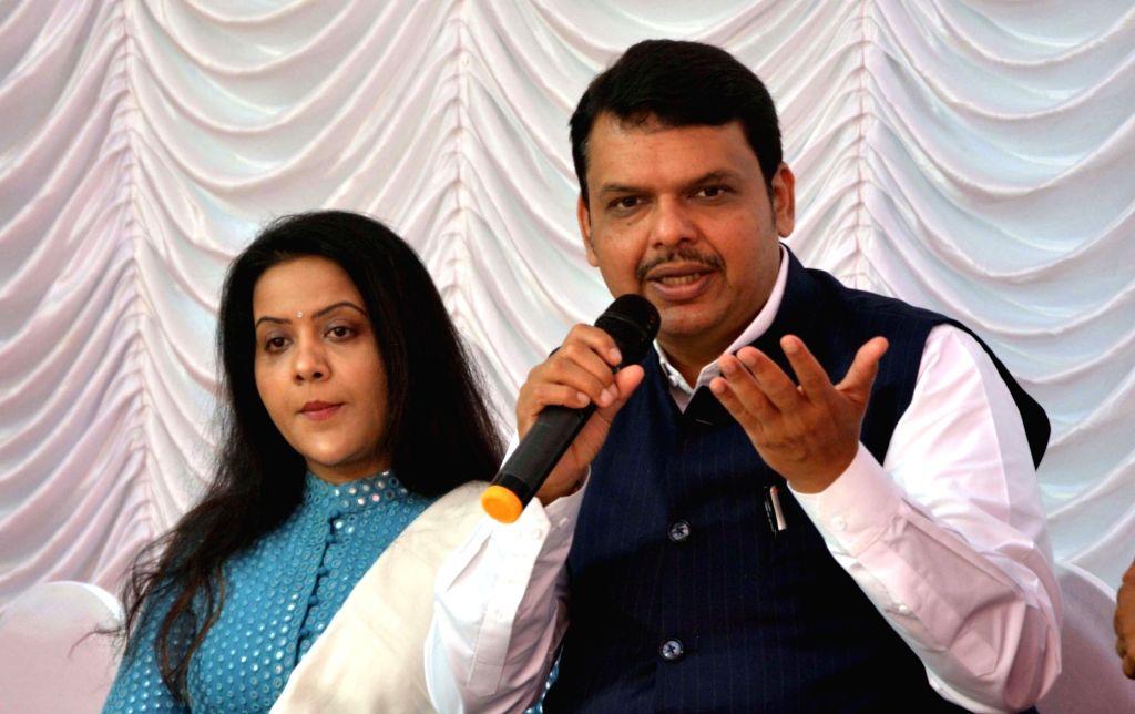 Maharashtra Chief Minister Devendra Fadnavis accompanied by his wife Amruta Fadnavis, addresses at a programme organised to celebrate Diwali in Mumbai on Nov 5, 2018. - Devendra Fadnavis