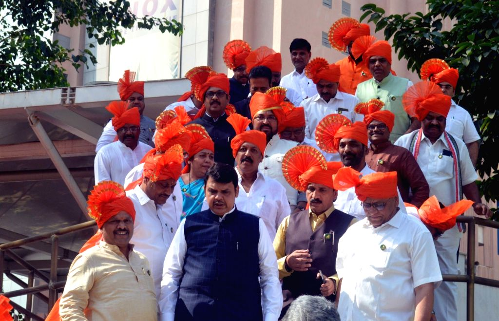 Maharashtra Chief Minister Devendra Fadnavis accompanied by Maratha leaders, comes out after attending the Winter session of Maharashtra Assembly, in Mumbai on Nov 29, 2018. The Maharashtra ... - Devendra Fadnavis