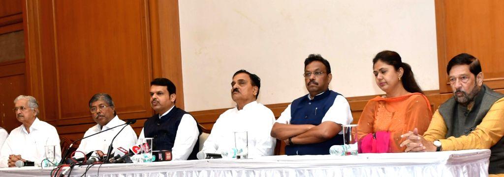 Maharashtra Chief Minister Devendra Fadnavis during a press conference in Mumbai on Feb 24, 2019. Also seen Maharashtra Cabinet Ministers Subhash Desai, Chandrakant Patil, Diwakar Raote, ... - Devendra Fadnavis, Subhash Desai, Chandrakant Patil, Diwakar Raote, Vinod Tawde, Pankaja Munde and Girish Bapat