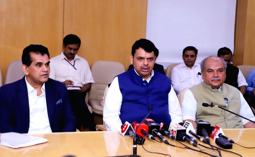Maharashtra Chief Minister Devendra Fadnavis interacts with the media after the High Powered Committee for Transformation of Indian Agriculture at NITI Aayog, in New Delhi on July 18, ... - Devendra Fadnavis