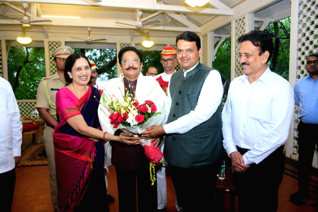 Maharashtra Chief Minister Devendra Fadnavis presents a bouquet of flowers to outgoing Governor of Maharashtra C. V. Rao and his wife during the farewell function at Raj Bhavan in Mumbai on ... - Devendra Fadnavis and C. V. Rao