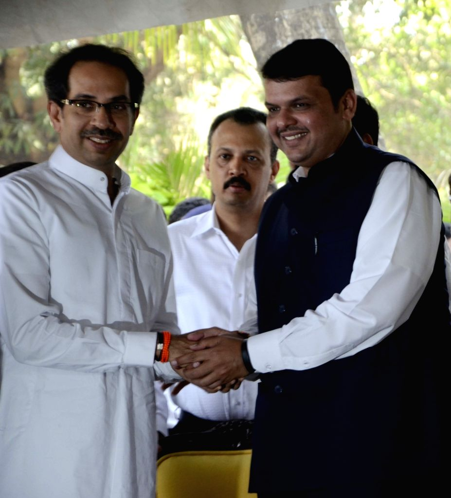Maharashtra Chief Minister Devendra Fadnavis and Shiv Sena chief Uddhav Thackeray during a press conference regarding setting up of a memorial for Balasaheb Thackeray at the Mayor`s Bunglow ... - Devendra Fadnavis