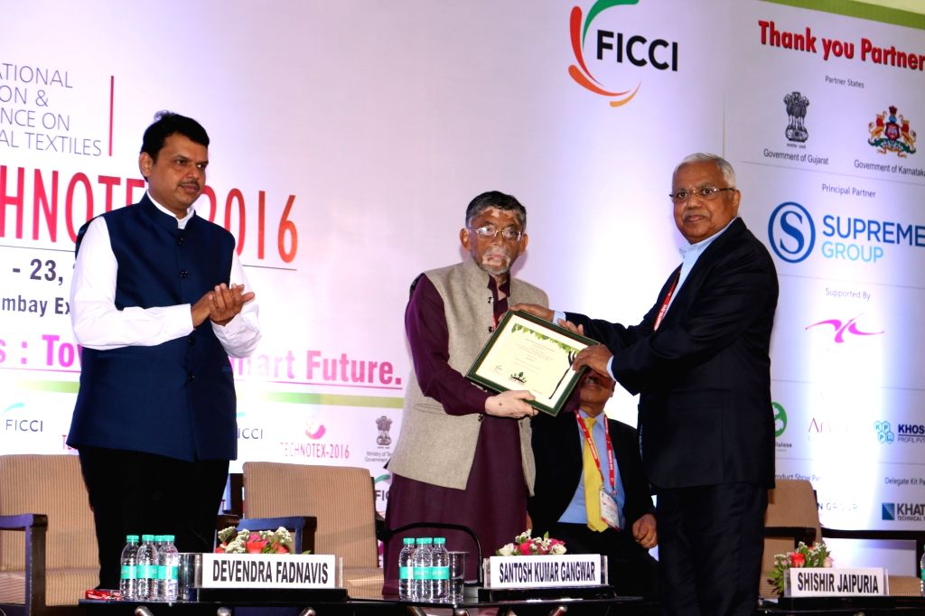 Maharashtra Chief Minister Devendra Fadnavis and Union textile minister Santosh Gangwar during the inauguration of the 5th edition of Technotex 2016 in Mumbai on April 21, 2016. - Devendra Fadnavis