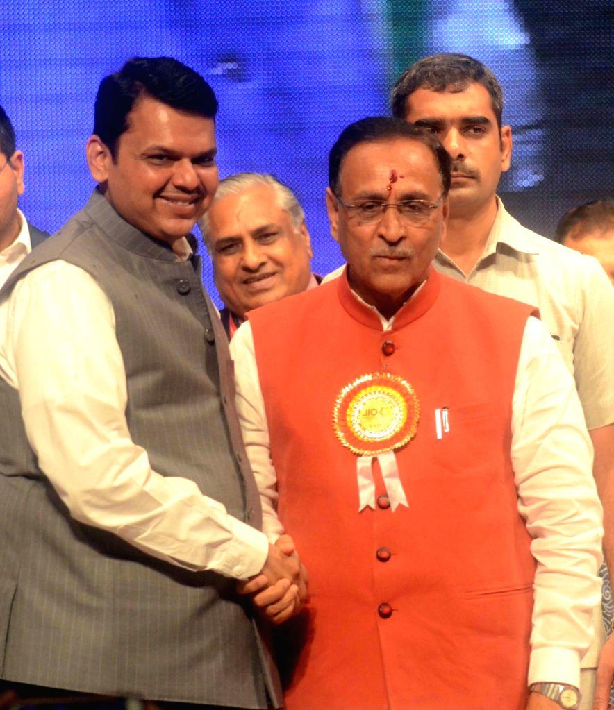 Maharashtra Chief Minister Devendra Fadnavis and Gujarat Chief Minister Vijay Rupani during a business conference in Mumbai on July 2, 2017. - Devendra Fadnavis