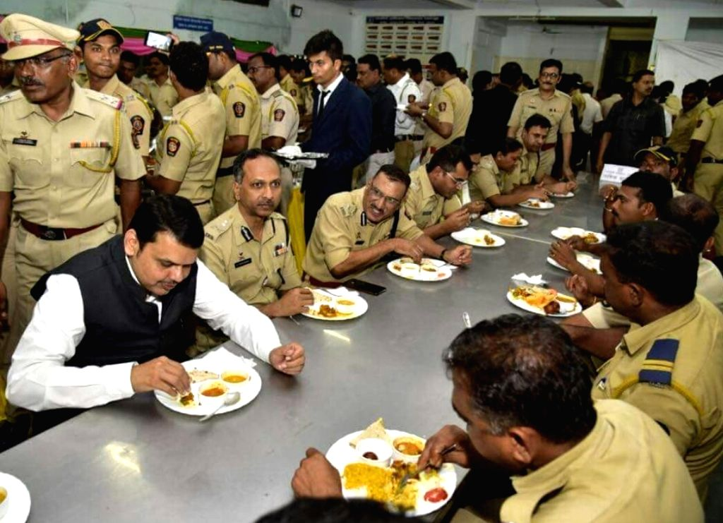 Maharashtra Chief Minister Devendra Fadnavis has lunch with police personnel at the state assembly, in Nagpur on July 14, 2018. - Devendra Fadnavis