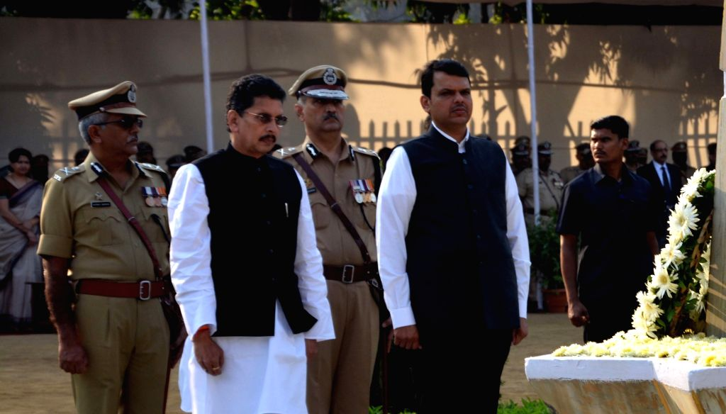 Maharashtra Chief Minister Devendra Fadnavis pays tribute to martyrs on Police Commemoration Day parade at Bhoiwada police ground in Mumbai on Oct 21, 2016. - Devendra Fadnavis