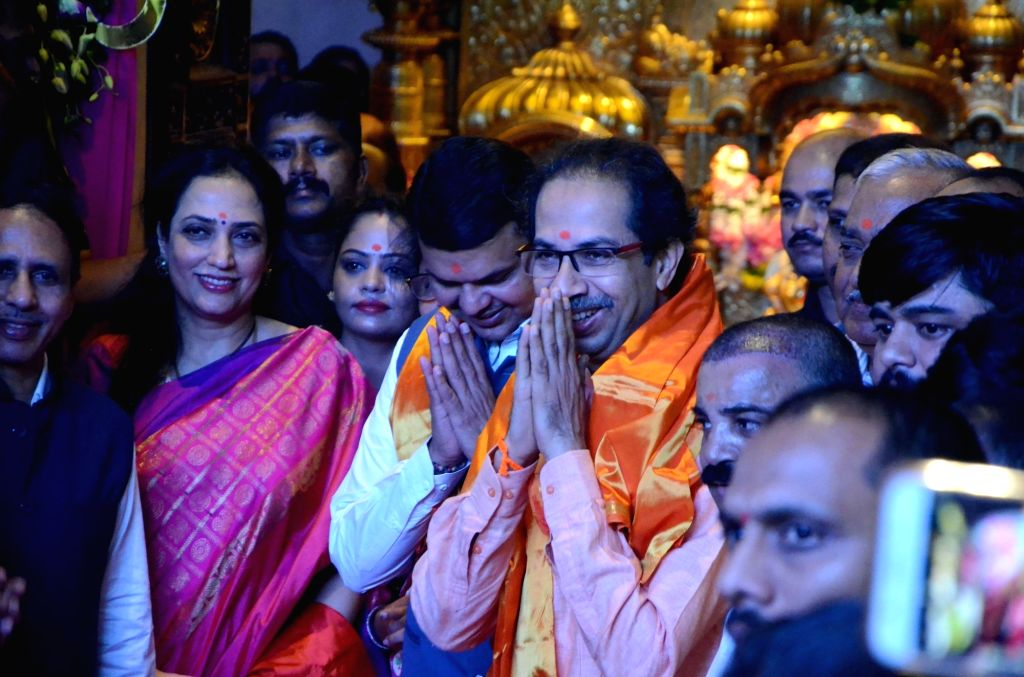 Maharashtra Chief Minister Devendra Fadnavis, Shiv Sena chief Uddhav Thackeray and his wife Rashmi Thackeray during a programme where they unveiled stamps at Siddhivinayak Temple, in Mumbai ... - Devendra Fadnavis