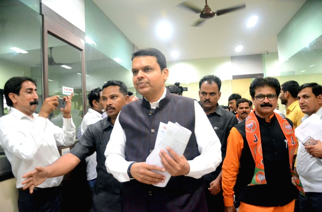 Maharashtra Chief Minister Minister and BJP leader Devendra Fadnavis arrives to attend party workers meeting in Mumbai on Aug 16, 2017. - Minister