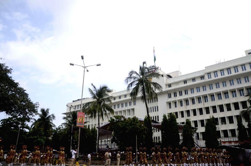 Maharashtra Chief Minister Prithviraj Chavan hoisting the national flag at Mantralaya in Mumbai on August 15, 2013. (Photo::: Sandeep Mahankal/IANS)