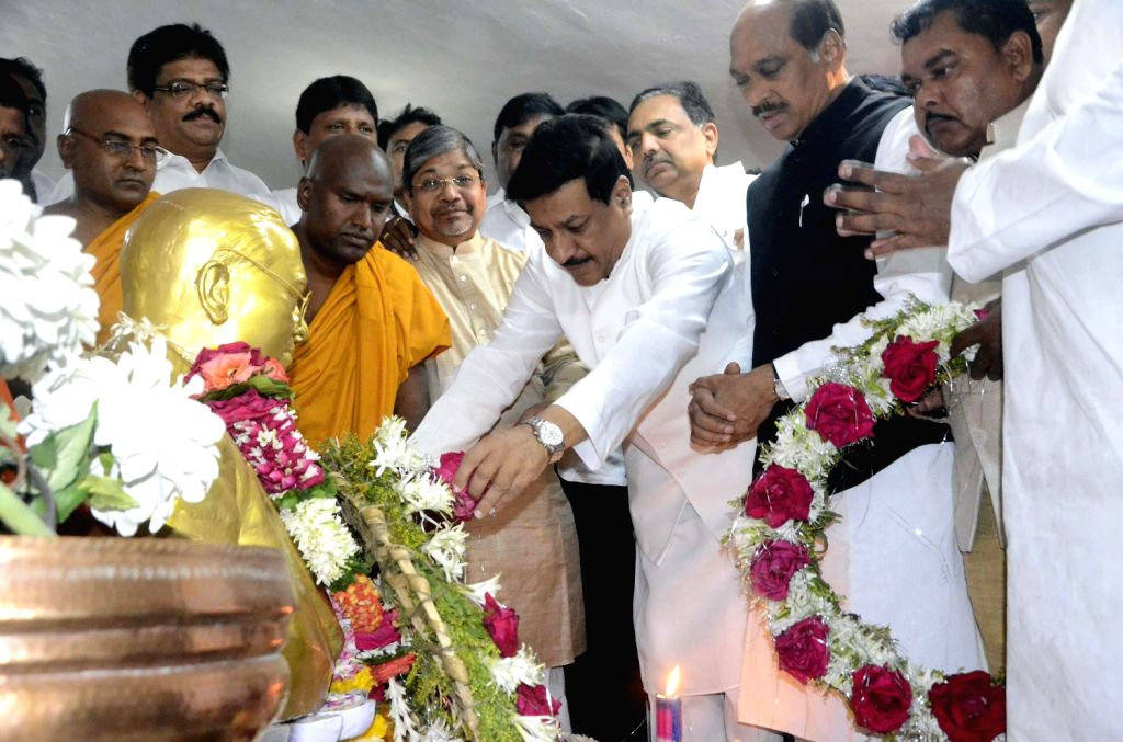 Maharashtra Chief Minister Prithviraj Chavan pays tribute to Bhimrao Ramji Ambedkar on his death anniversary with Congress president for Maharashtra Manikrao Thackeray and others at Chaityabhoomi in .