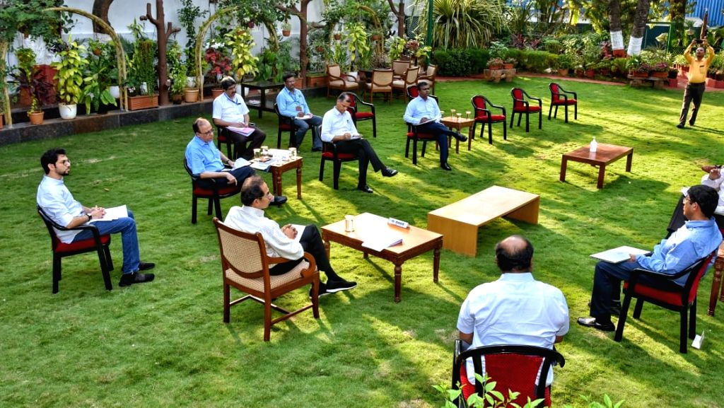 Maharashtra Chief Minister Uddhav Thackeray and his cabinet colleagues practise social distancing as they hold a meeting at Varsha Bungalow lawns in Mumbai on Day 2 of the 21-day nationwide ... - Uddhav Thackeray and Narendra Modi