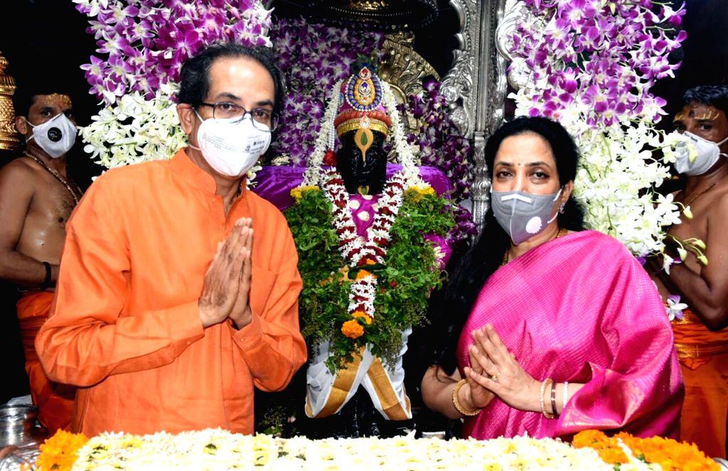 Maharashtra Chief Minister Uddhav Thackeray and his wife Rashmi Thackeray offer prayers to Lord Vitthala on the occasion of Ashadhi Ekadashi, at Pandharpur in Solapur district of ... - Uddhav Thackeray