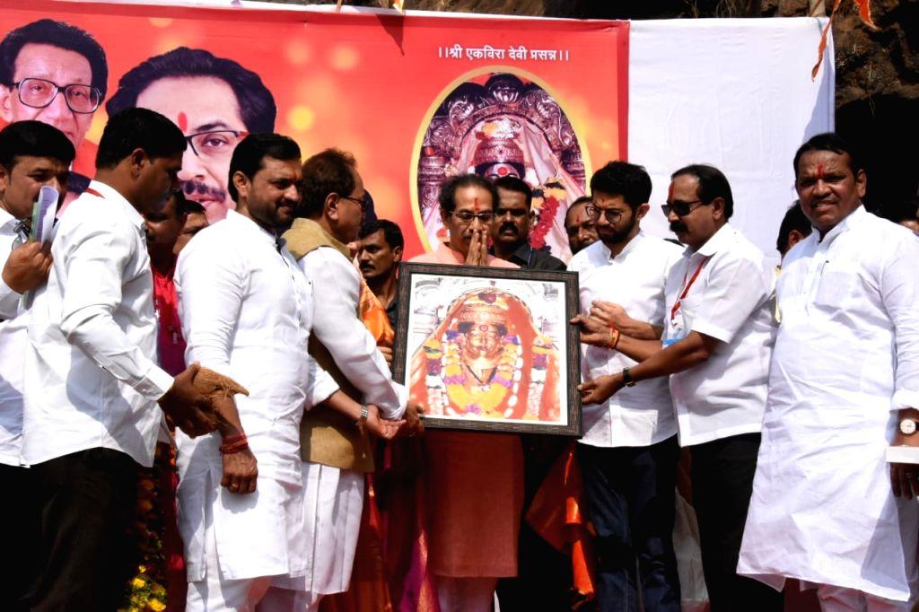 Maharashtra Chief Minister Uddhav Thackeray being welcomed on his visit to Shivneri Fort near Junnar in Pune on Dec 12, 2019. - Uddhav Thackeray