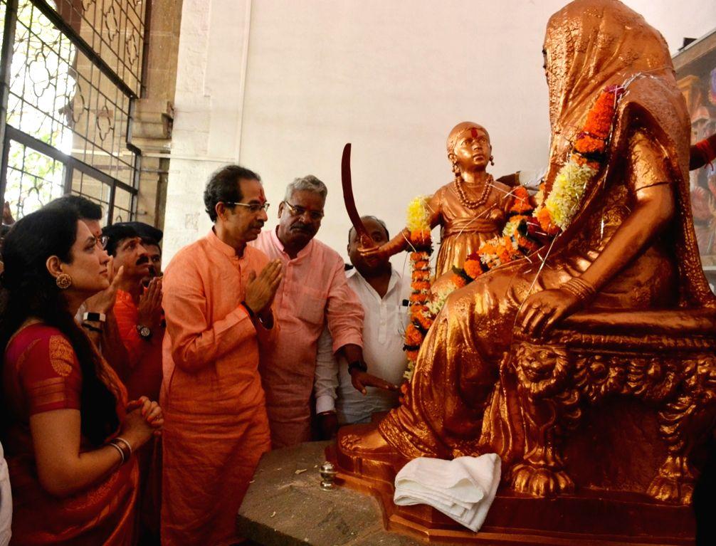 Maharashtra Chief Minister Uddhav Thackeray, his wife Rashmi Thackeray and son Aditya Thackeray pay homage to Jijabai Bhosale, also known as Rajmata and her son legendary Maratha king and ... - Uddhav Thackeray