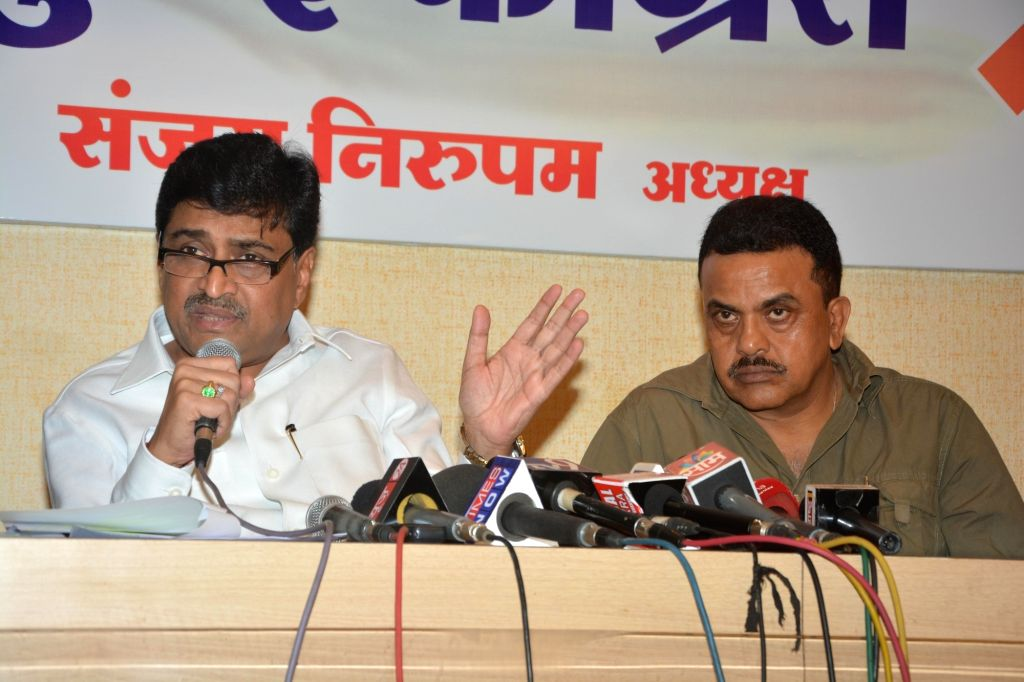 Maharashtra Congress chief Ashok Chavan (L) addresses a press conference in Mumbai on May 19, 2017. Also seen Mumbai Congress chief Sanjay Nirupam (R).