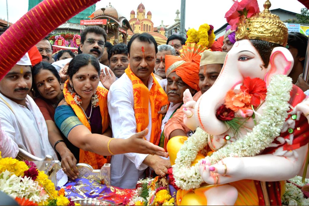 Maharashtra Deputy Chief Minister Ajit Pawar participates in a Ganesh immersion procession in Pune on Sept 9, 2014.
