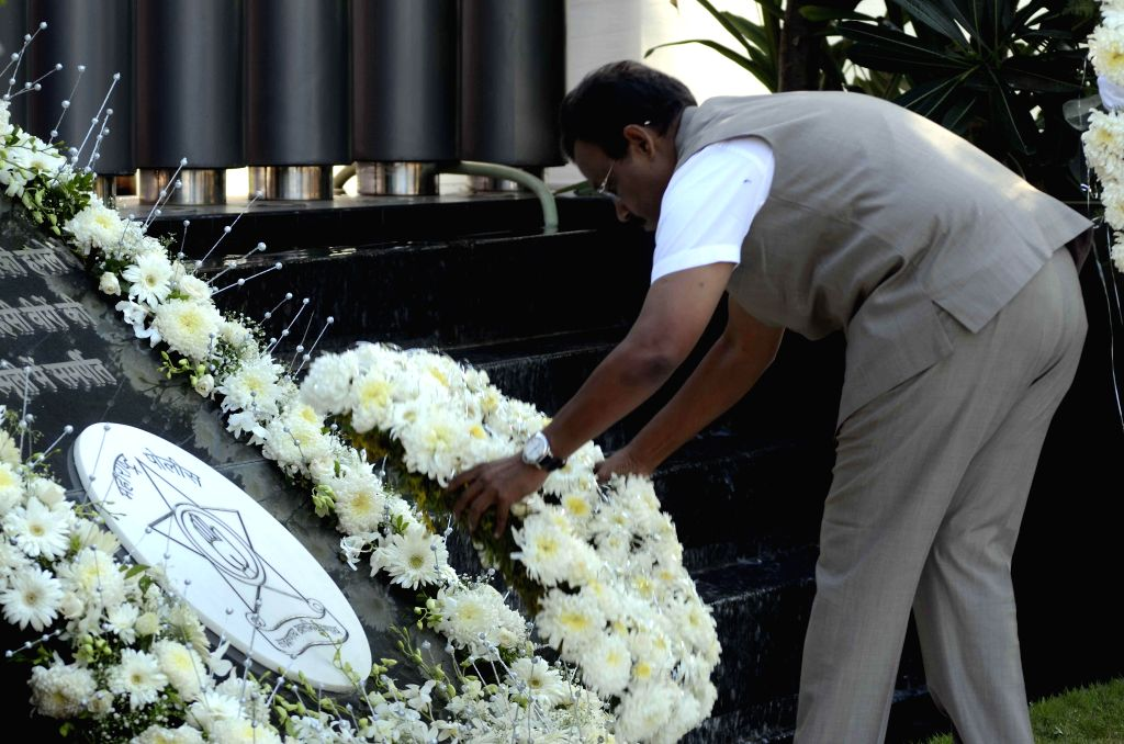 Maharashtra Education Minister Vinod Tawde pays homage to those killed in the 26/11 attacks during a programme at Police Gymkhana in Mumbai on Nov.26, 2014.Ten heavily armed Pakistani terrorists had .