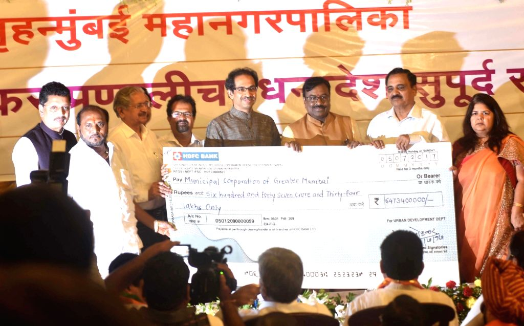 Maharashtra Finance Minister Sudhir Mungantiwar hands over a cheque of Rs.647 crore to the BMC as a compensation for the losses it would suffer after its biggest revenue source, octroi was ... - Sudhir Mungantiwar
