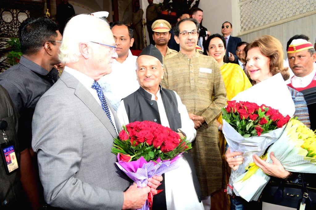 Maharashtra Governor BS Koshyari and Chief Minister Uddhav Thackeray welcome King Carl XVI Gustaf and Queen Silvia of Sweden at Raj Bhavan in Mumbai on Dec 4, 2019. - Uddhav Thackeray