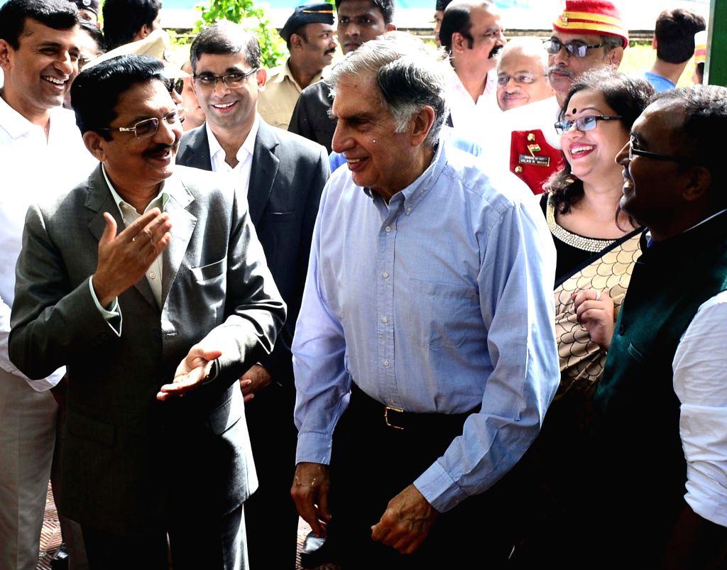 Maharashtra Governor C Vidyasagar Rao and Chairman emeritus of Tata Sons, Ratan Tata during the inauguration of 'Peacock Conservation Project' at Raj Bhavan in Mumbai on July 1, 2016. - Ratan Tata and C Vidyasagar Rao