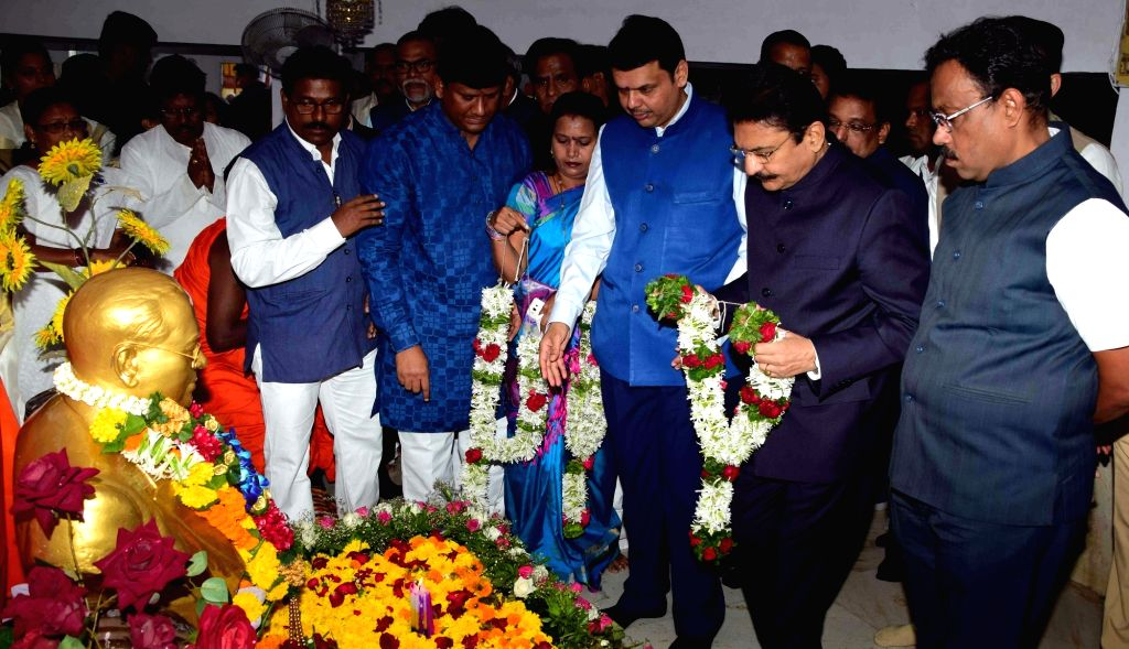 Maharashtra Governor C Vidyasagar Rao and Chief Minister Devendra Fadnavis pay tribute to Dr BR Ambedkar on his 125th birth anniversary celebration in Mumbai on April 14, 2016. Also seen BJP ... - Devendra Fadnavis and C Vidyasagar Rao