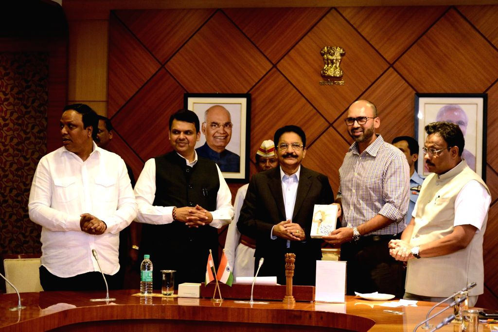 Maharashtra Governor C. Vidyasagar Rao felicitates U-19 cricket team coach Paras Mambrey in the presence of the state's Chief Minister Devendra Fadnavis in Mumbai on Feb 7, 2018. - Devendra Fadnavis and C. Vidyasagar Rao