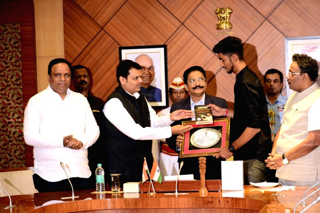 Maharashtra Governor C. Vidyasagar Rao felicitates U-19 cricket team player Aditya Thakare in the presence of the state's Chief Minister Devendra Fadnavis in Mumbai on Feb 7, 2018. - Devendra Fadnavis and C. Vidyasagar Rao