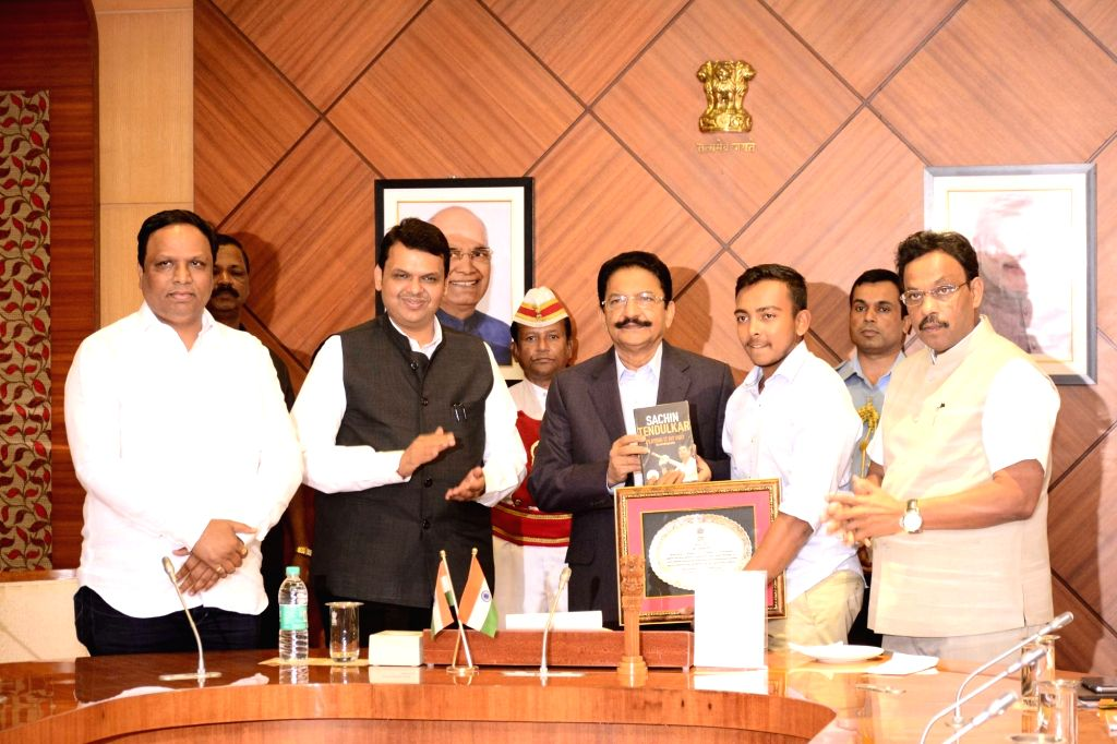Maharashtra Governor C. Vidyasagar Rao felicitates U-19 cricket team captain Prithvi Shaw in the presence of the state's Chief Minister Devendra Fadnavis in Mumbai on Feb 7, 2018. - Prithvi Shaw and C. Vidyasagar Rao
