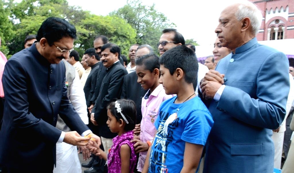 Maharashtra Governor Chennamaneni Vidyasagar Rao interacts with children on Independence Day in Pune on Aug 15, 2016. - Chennamaneni Vidyasagar Rao