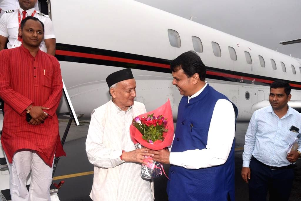Maharashtra Governor designate Bhagat Singh Koshyari being welcomed by Chief Minister Devendra Fadnavis on his arrival at the Chhatrapati Shivaji International Airport in Mumbai on Sep 4, ... - Devendra Fadnavis and Bhagat Singh Koshyari