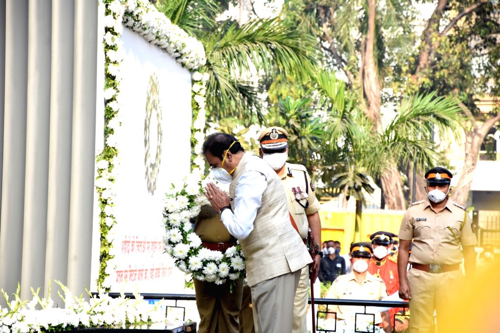 Maharashtra Home Minister Anil Deshmukh pays tributes to the martyrs and victims felled by bullets and brave-hearts who helped save and secure the city from the assault by 10 Pakistani ... - Anil Deshmukh