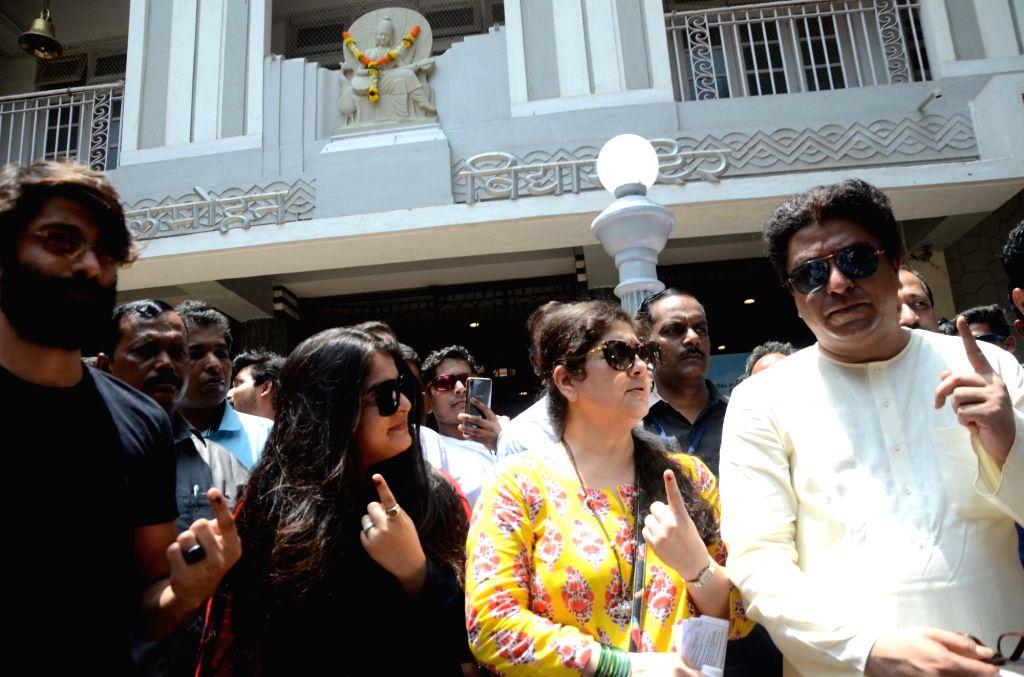 Maharashtra Navnirman Sena chief Raj Thackeray and his wife Sharmila Thackeray show their inked fingers after casting their votes for the fourth phase of 2019 Lok Sabha elections in Mumbai, ...