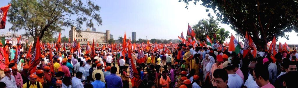 Maharashtra Navnirman Sena (MNS) workers, activists and supporters participate in a mega-morcha (procession) led by MNS President Raj Thackeray demanding the ouster of Pakistani-Bangladeshi ...