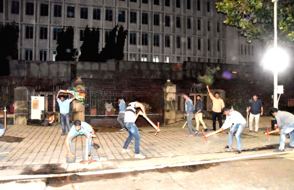 Maharashtra Navnirman Sena (MNS) workers try to dig the pavement outside Maharashtra Secretariat to protest against BMC and state government's approach towards filling of potholes across ...