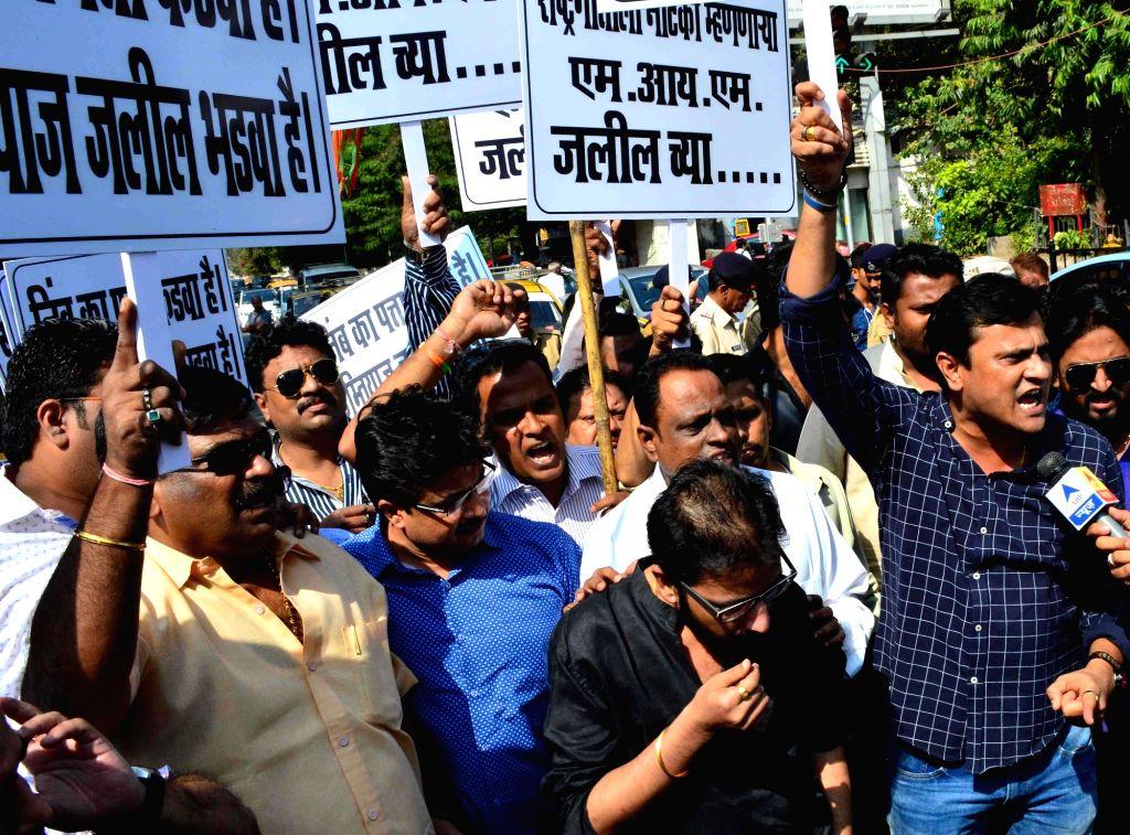 Maharashtra Navnirman Sena workers stage a demonstration against AIMIM MLA Imtiyaz Jalil's remarks on the national anthem in Mumbai, on Dec 1, 2015.
