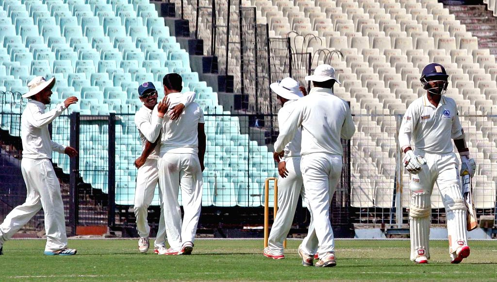 Maharashtra players celebrate fall of Dinesh Karthik`s wicket during a Ranji Trophy Semi Final match between Tamil Nadu and Maharashtra at Eden Gardens in Kolkata on Feb 26, 2015.