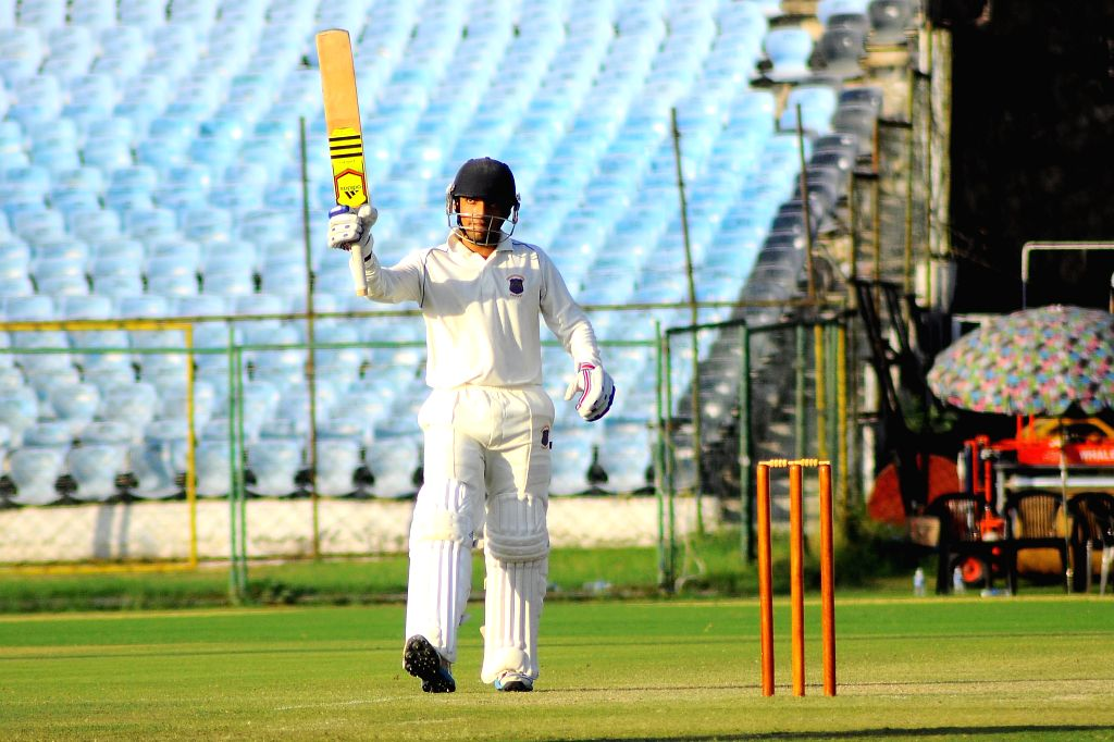Maharashtra Ranji player Chirag Gulshan Khurana celebrates half century during a Ranji Trophy match between Maharashtra and Rajasthan at Sawai Mansingh Stadium in Jaipur, on Oct 23, 2015.