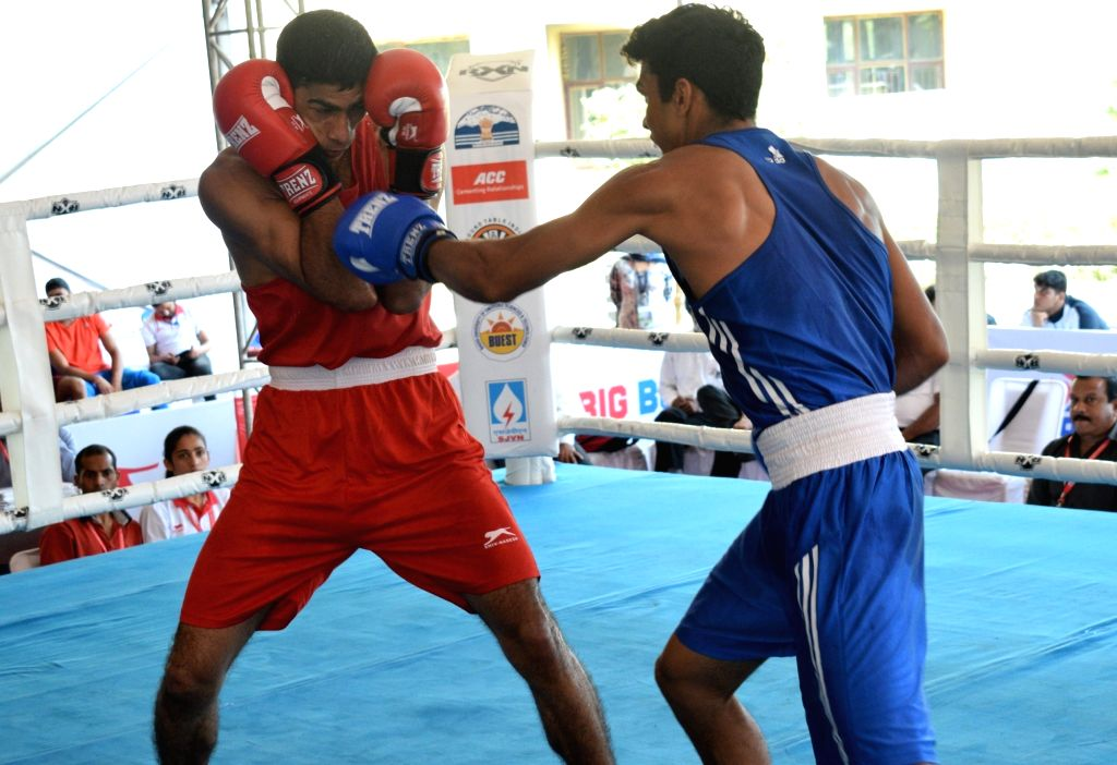 Maharashtra???s Ajay Pendor in action against Amit Kumar Chaurasia of Chattisgarh during a quarter-final match in the 46-49 kg category of the 4th Elite National Men's Boxing Championship at ... - Amit Kumar Chaurasia