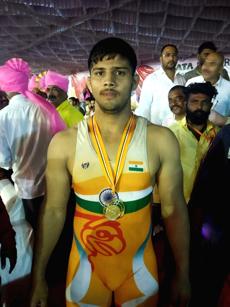 Maharashtra's Sikandar pose with his medal on the first day of 2nd Tata Motors U-23 National Wrestling Championship in Shirdi, Maharashtra on Sep 27, 2019.