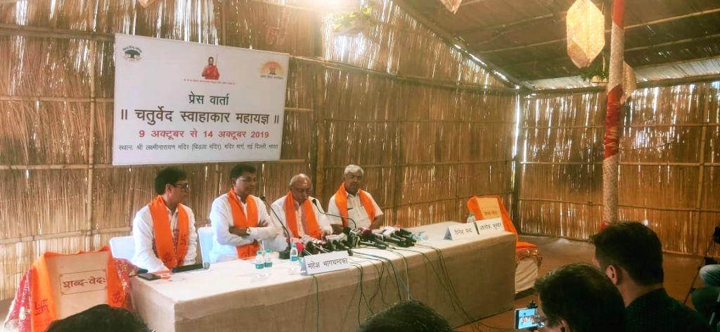 "Mahesh Bhagchandka of Ashok Singhal foundation addresses a press conference on 6-day programme ""Chaturved Swahakaar Maha Yagna"" to be organised by the Vishwa Hindu Parishad to ..."